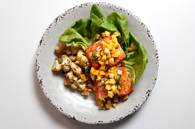 Plate with Lettuce, Basic Seared Salmon, Cauliflower and Mango Salsa