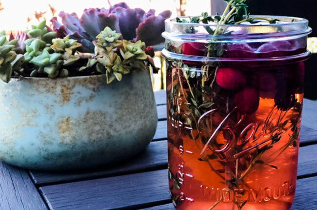Mason jar of cranberry Orange Vinegar