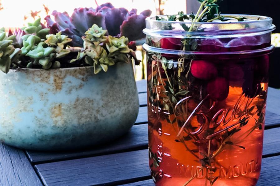 Mason jar of cranberry Orange Vinegar