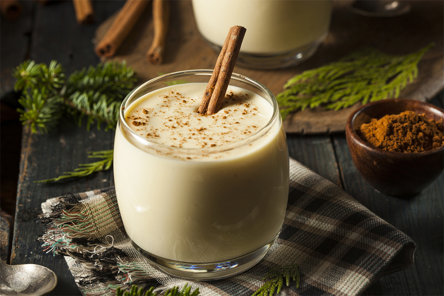 "Glass cup of Eggless ""Eggnogg"" Smoothie with a cinnamon stick"