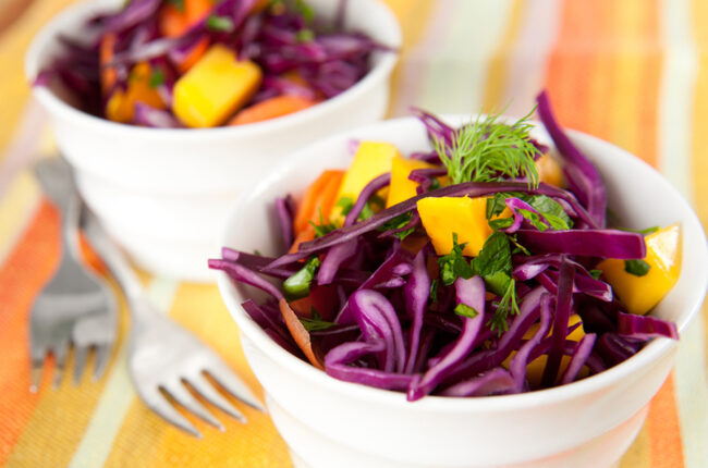 2 bowls of Mango, Carrot, Purple Cabbage, and Cilantro Salad with Miso Ginger Dressing
