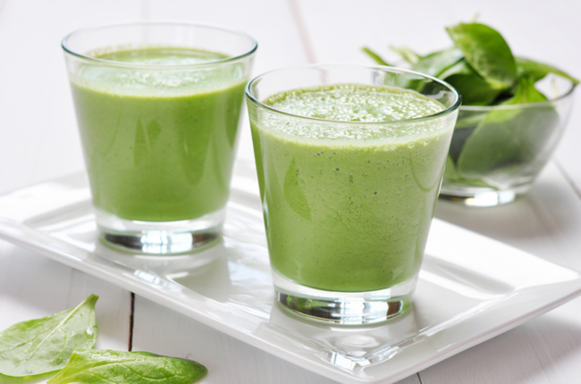 Two glasses of Sneaky Green Smoothie on a plate