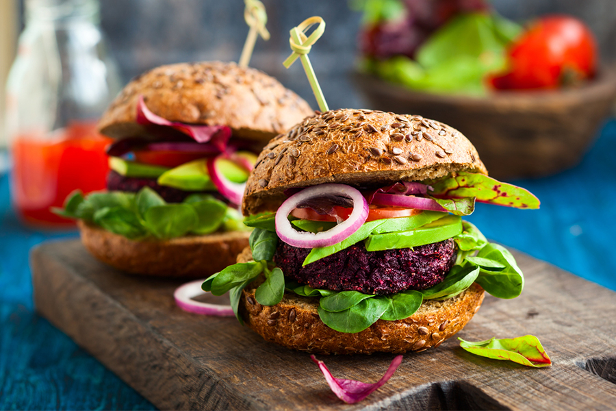 2 Turmeric Beat Burgers on a cutting board