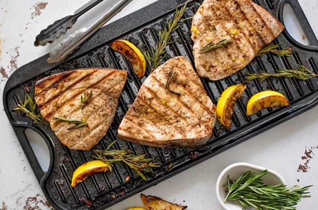 3 swordfish fillets on a grill pan