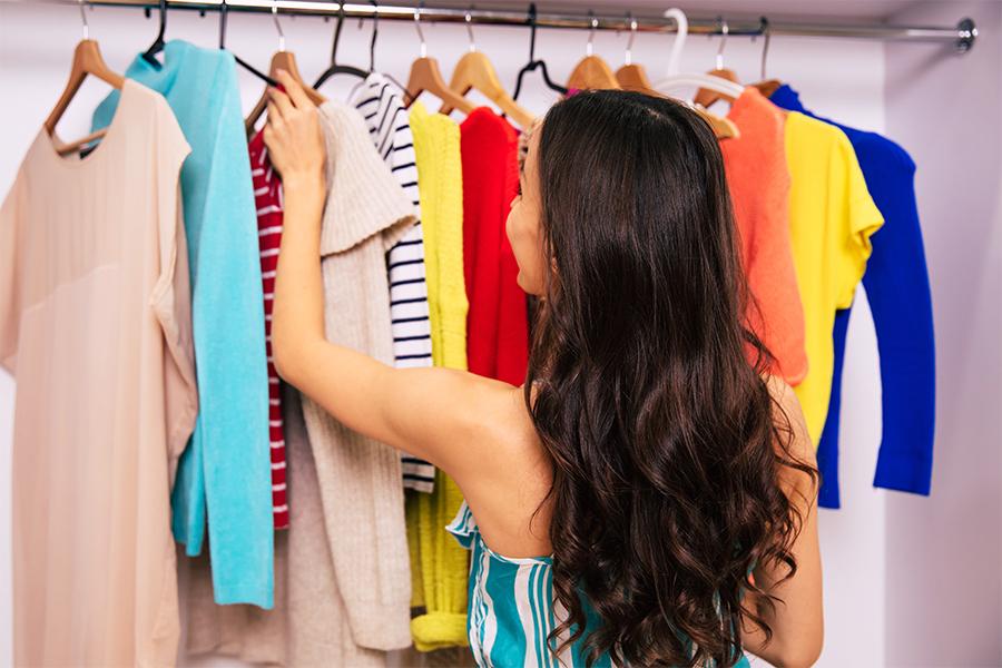 Woman looking through her closet