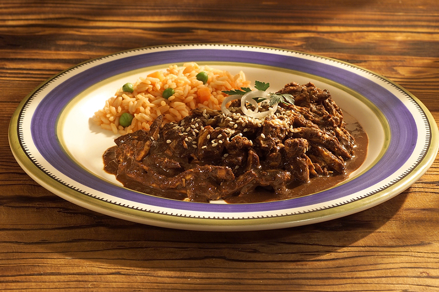 Plate of chicken mole and spanish rice