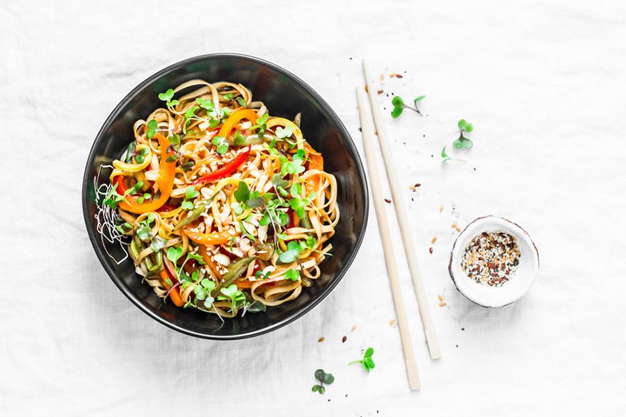 Pad Thai Salad with Garlic-Ginger Shrimp in a bowl
