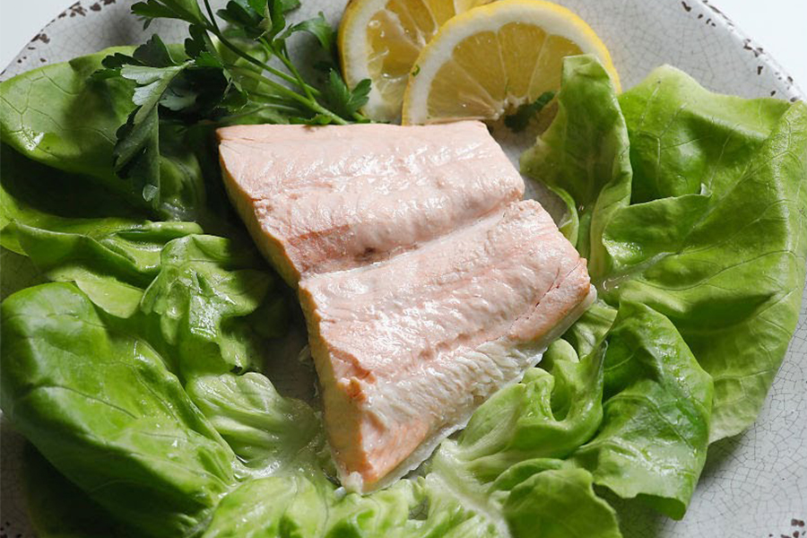 Poached Salmon on a bed of lettuce