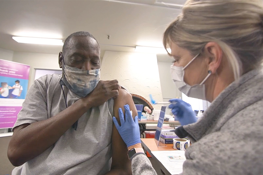 Elderly Black man gets vaccinated