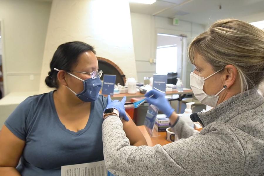 Teacher getting COVID-19 vaccine