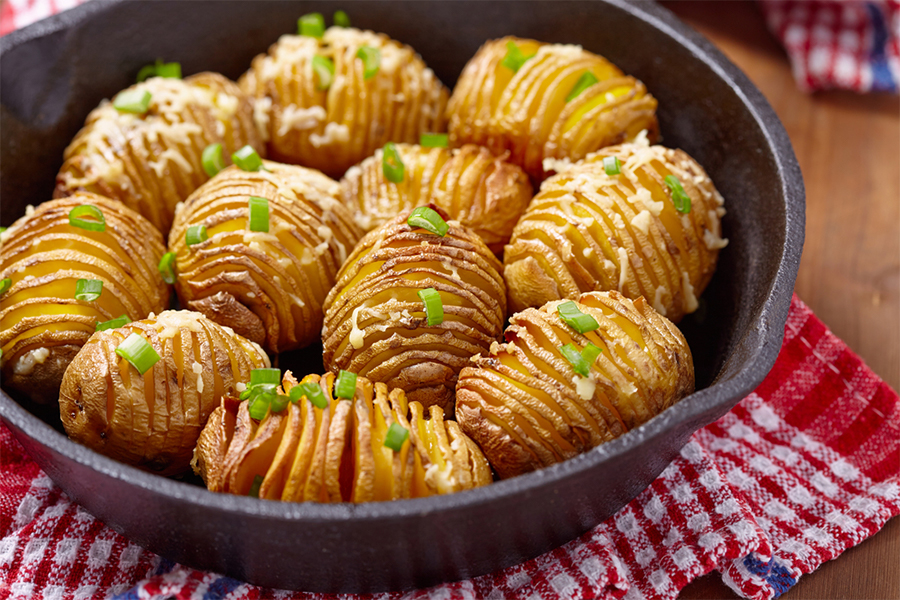 11 hasselback potatoes in a cast iron pan