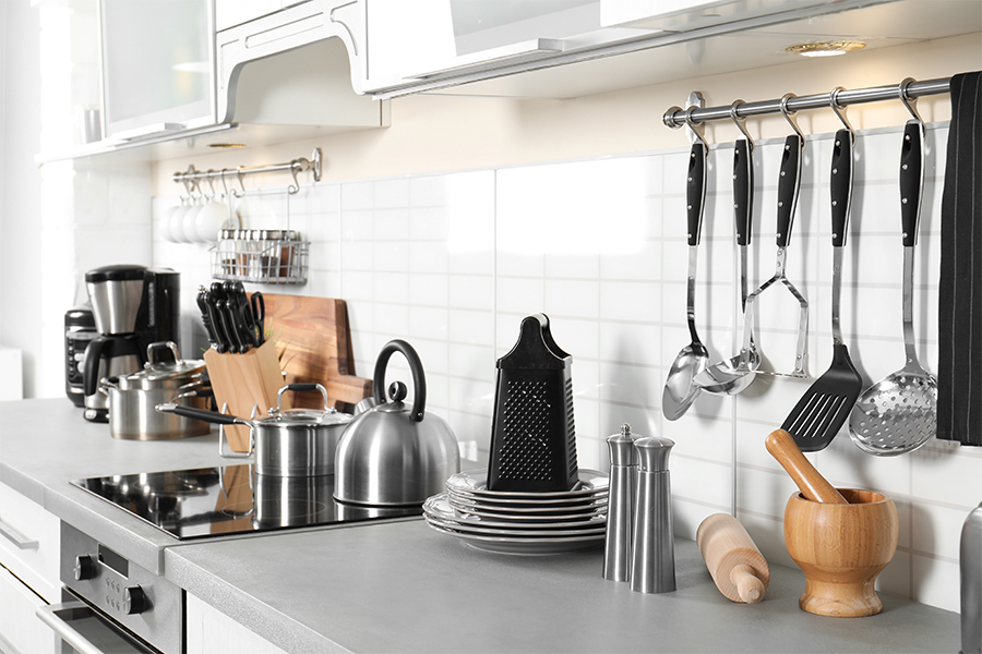 Kitchen counter with tools, wares, accessories.