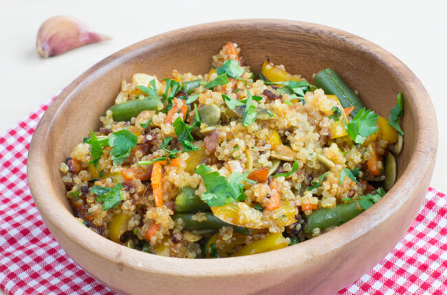 Carrot and Quinoa Salad with Fish Sauce in a wooden bowl