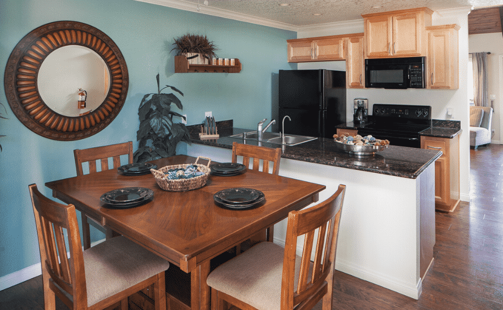 dining area and kitchen interior with blue wall and light wood cabinets