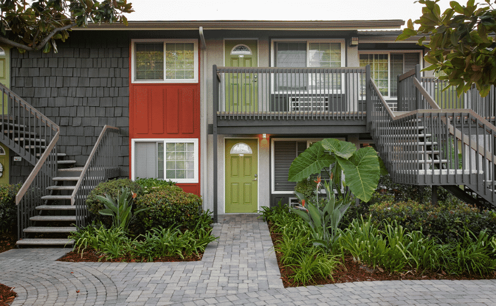View of the front of an apartment with a green door