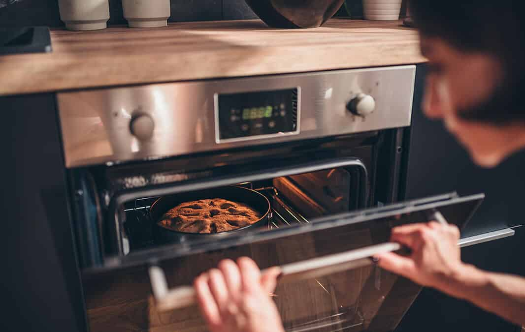 woman baking food in oven