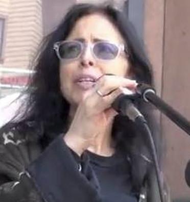 Ann Garison at microphone
