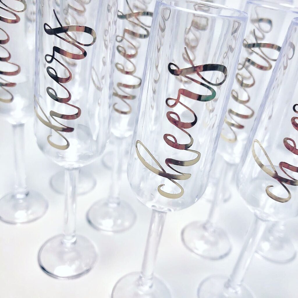 Mini champagne glasses with cheers vinyl lettering