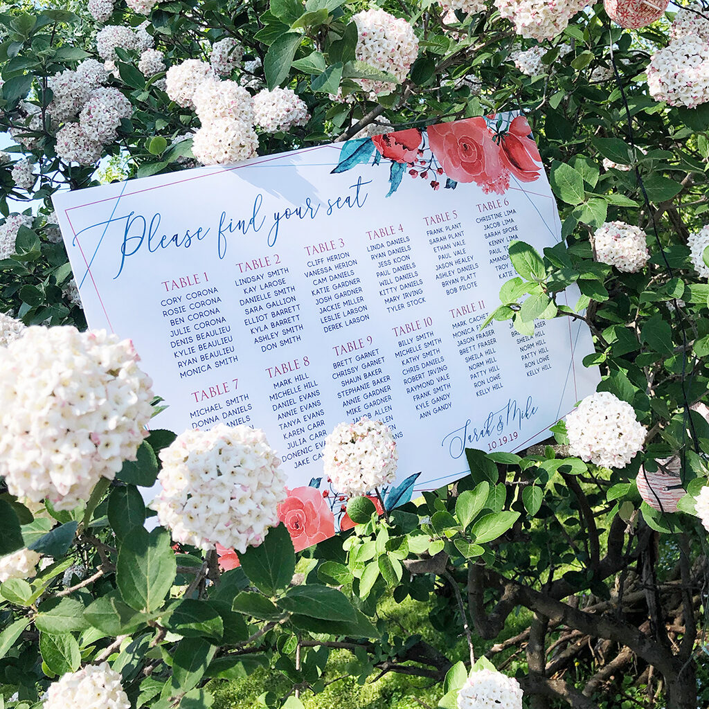 wedding seating chart on a flower bush