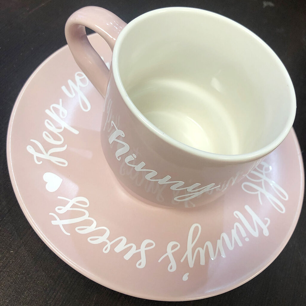 pink teacup with vinyl lettering