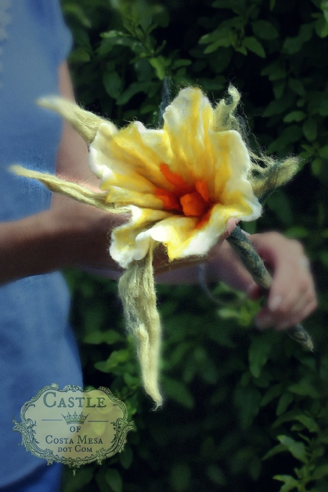 130605 Christine holding Josephine's wet-felted white flower with large light green sepals and orange carpel and stamens..