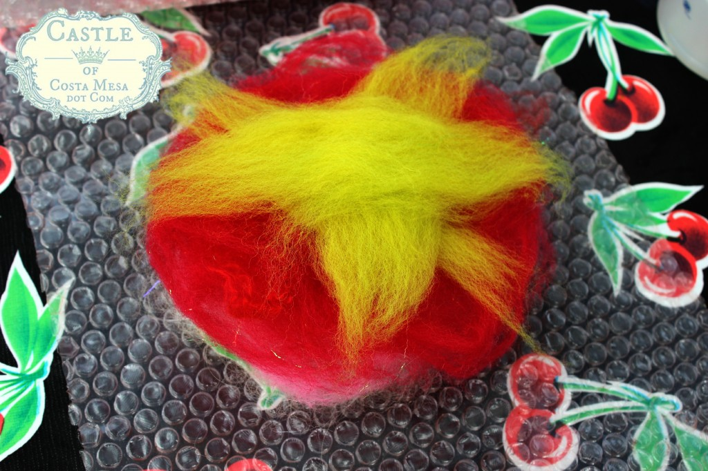 130605 Jzin's arrangement of wool roving colors to form a flower with sepals