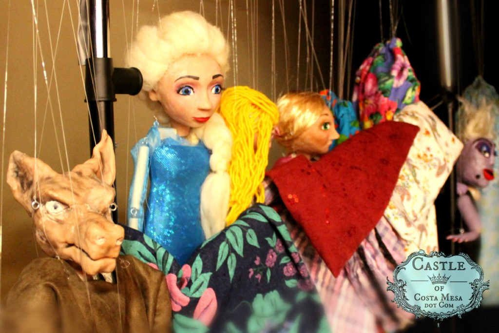 1827 150613 WSOC 9th Grade Marionette Show handmade string puppets by students on a rack