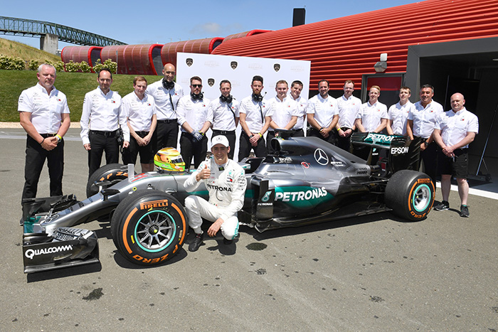 The Mercedes AMG Petronas F1 Team with Esteban Gutierrez and the W07/04.