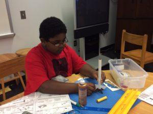 Student building rocket.