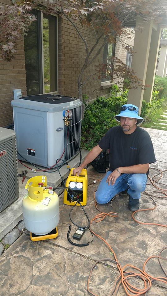 Man servicing an air conditioner
