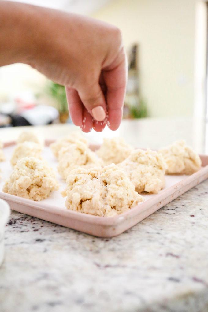 sprinkling sanding sugar on shortcake