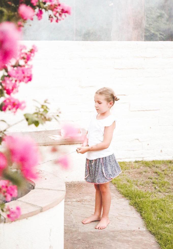 little girl roasting marshmallows