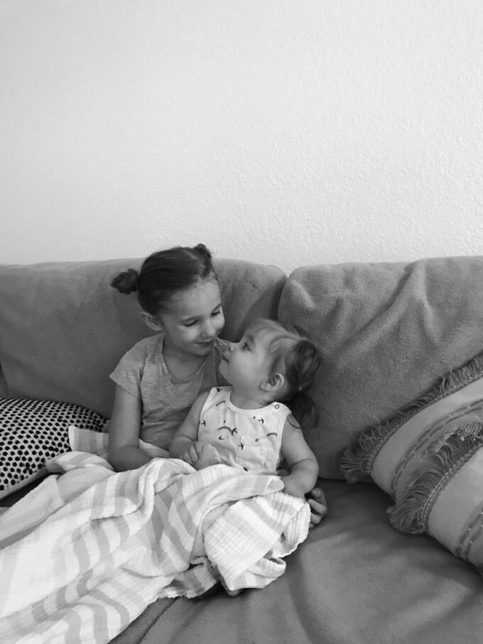 sisters looking at each other lovingly