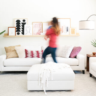 blurred woman walking in front of modern furniture