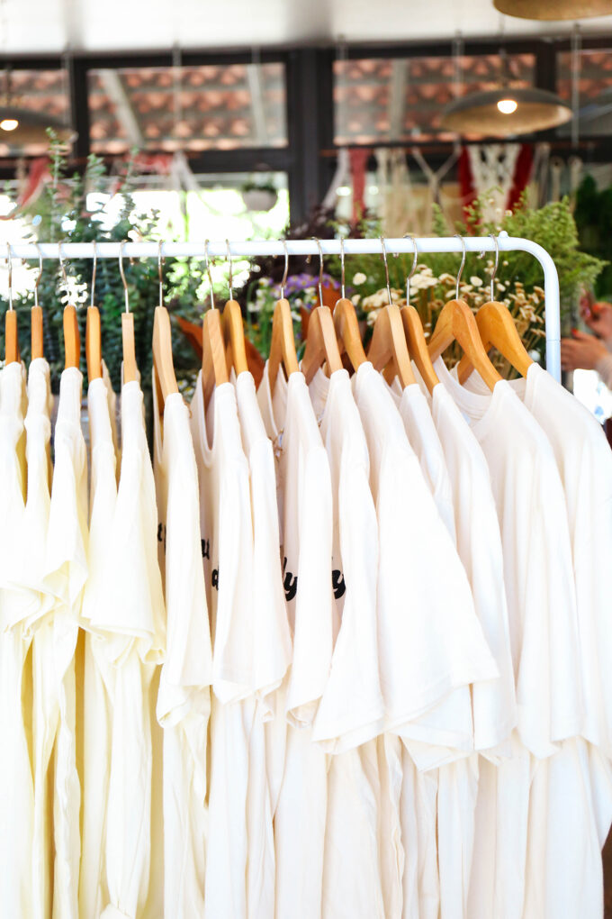 tee shirts on clothing rack