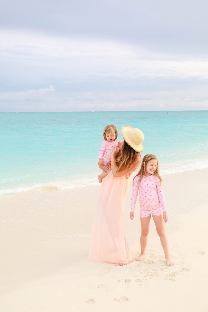 mom and two daughters on beach