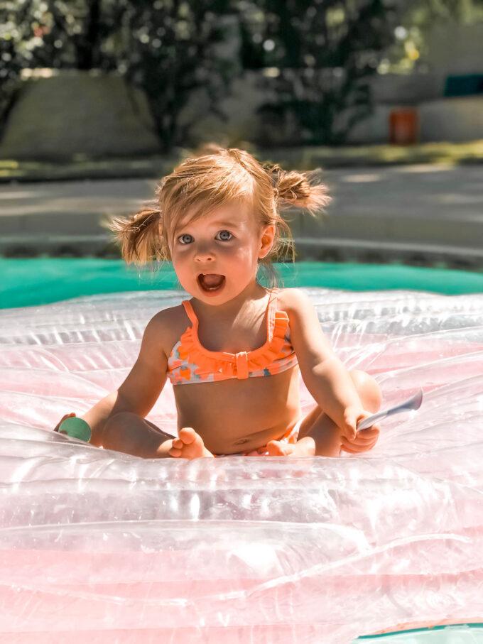 toddler girl in swimsuit
