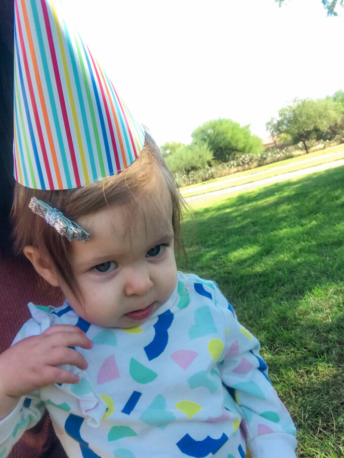 baby wearing a party hat