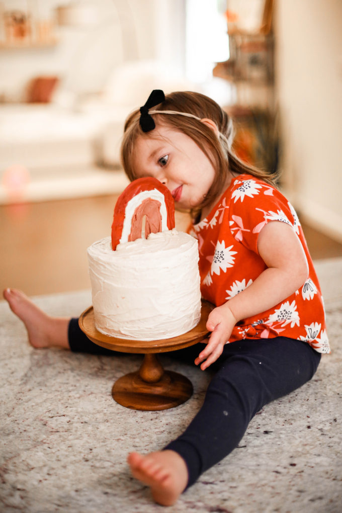 little girl eating birthday cake