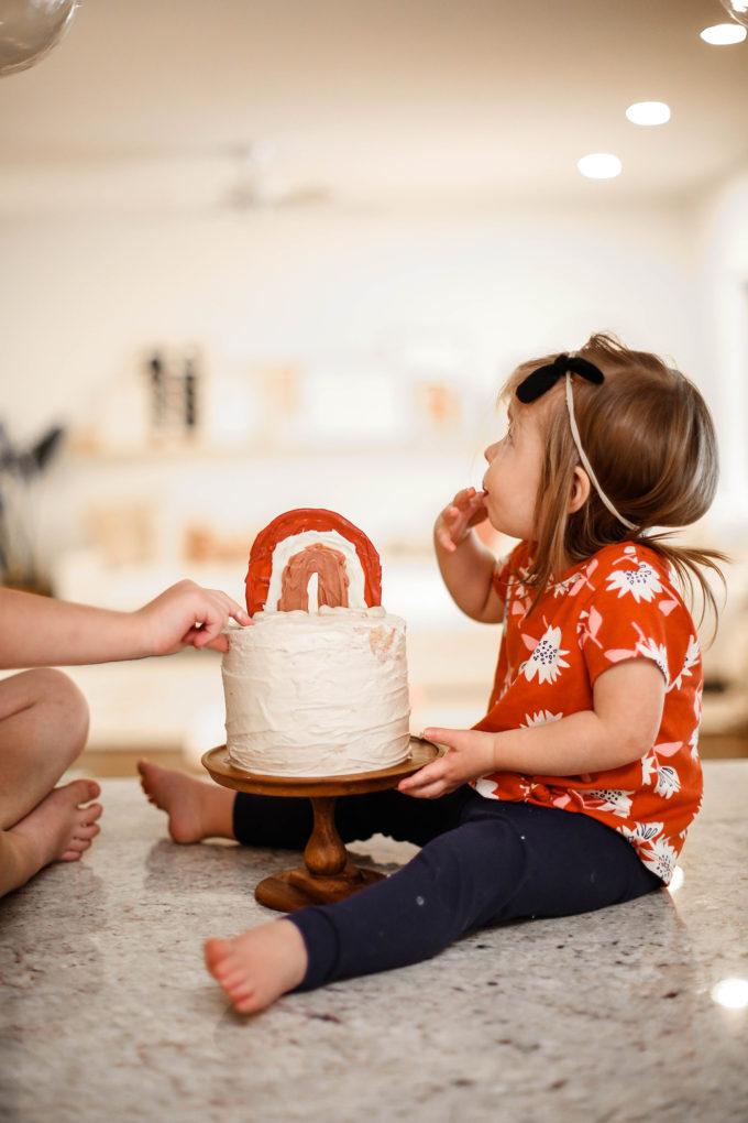 little girl eating birthday cake