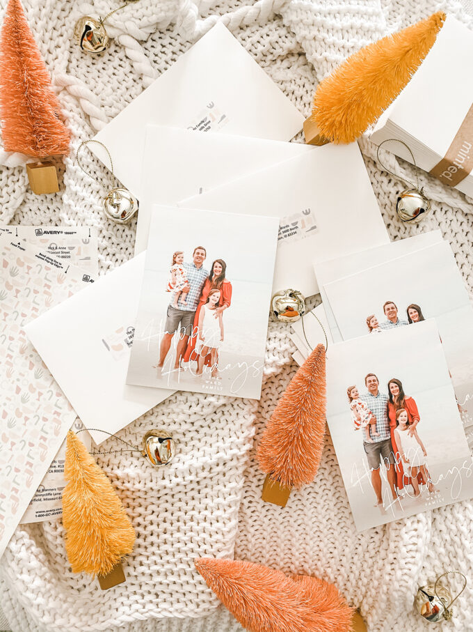 holiday cards scattered with bells and sisal trees