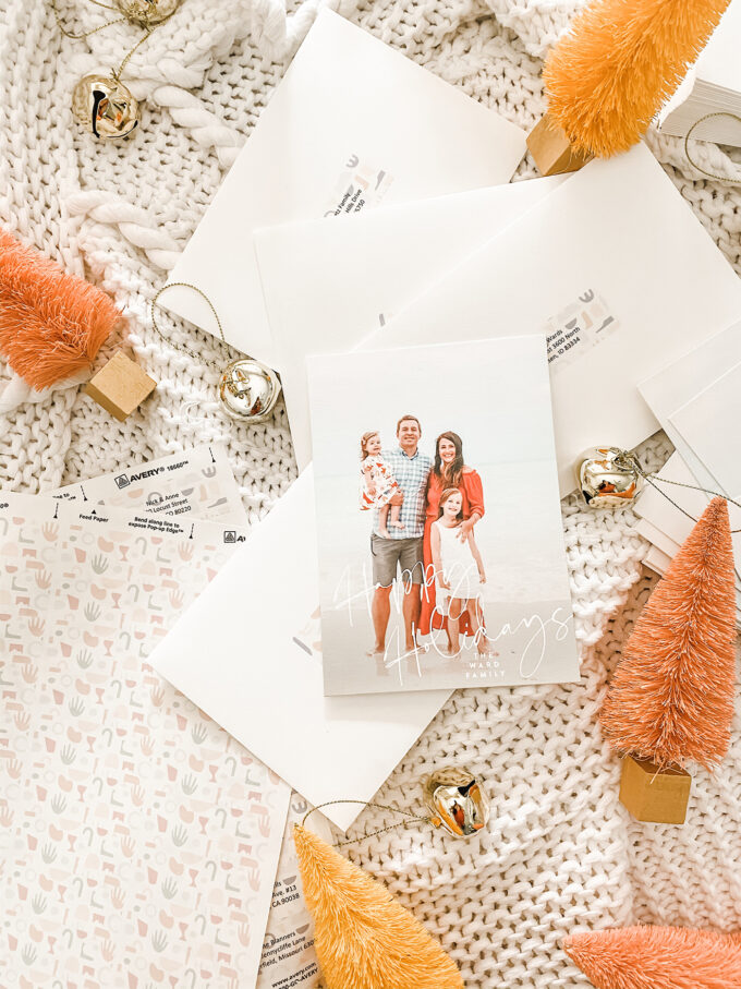 holiday mailing cards scattered with bells and sisal trees