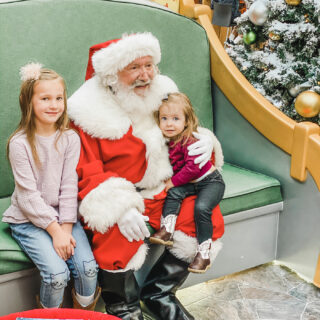 little girls sitting with Santa