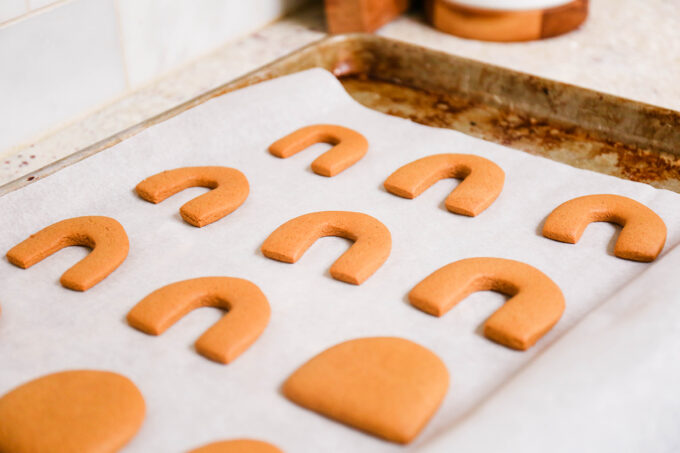 gingerbread cookie cutouts cooling on sheet