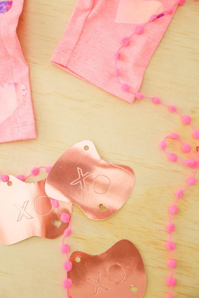 valentine's day items in flatlay with pink ribbon