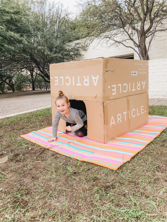 little girl in box fort