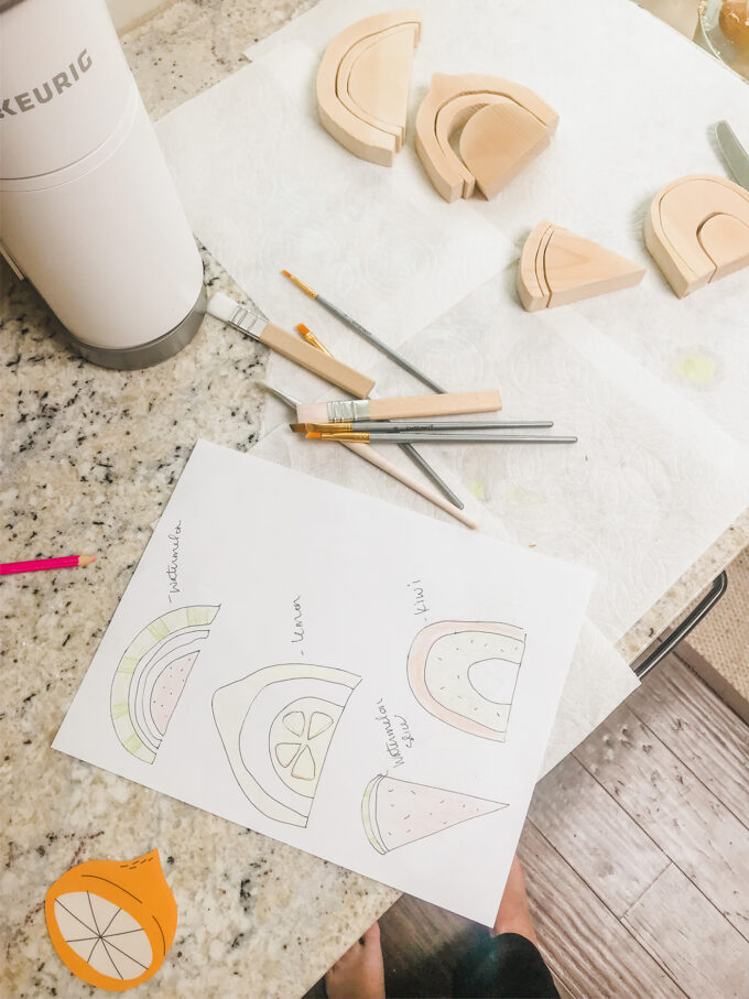 wooden rainbow cutouts with plan for coloring and design