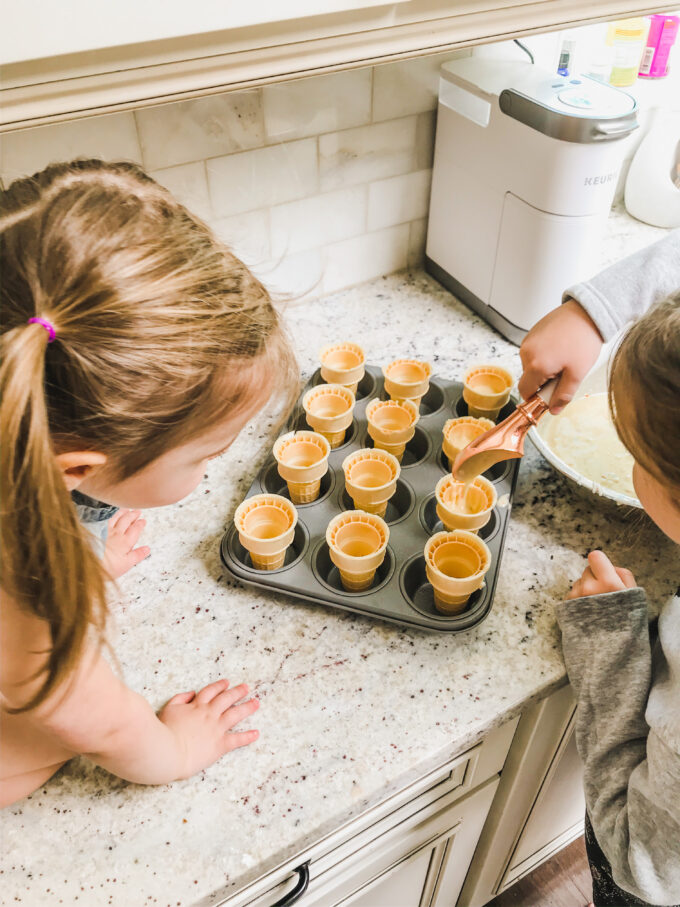 Funfetti Cupcake Cones - little girl filling cones with batter