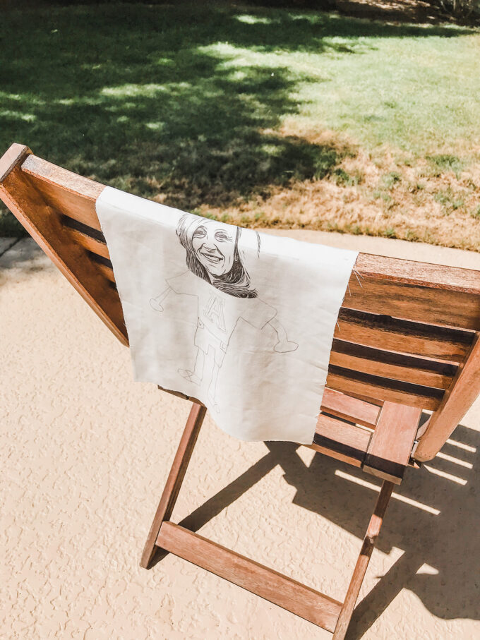 printed fabric laying outside on chair to dry