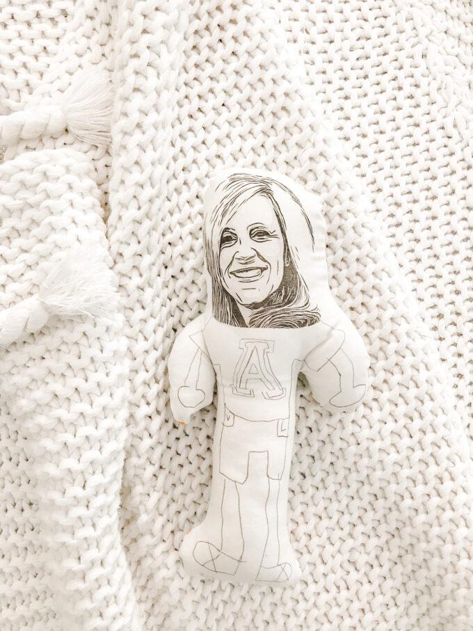 homemade doll flatlay on blanket